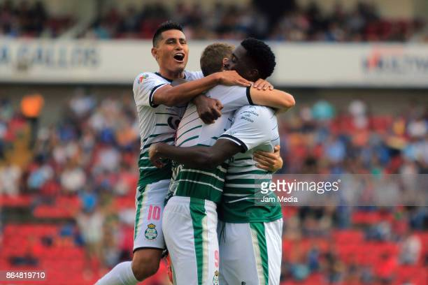 Julio Furch of Santos celebrates with teammates after scoring his team's second goal during the 14th round match between Queretaro and Santos Laguna...