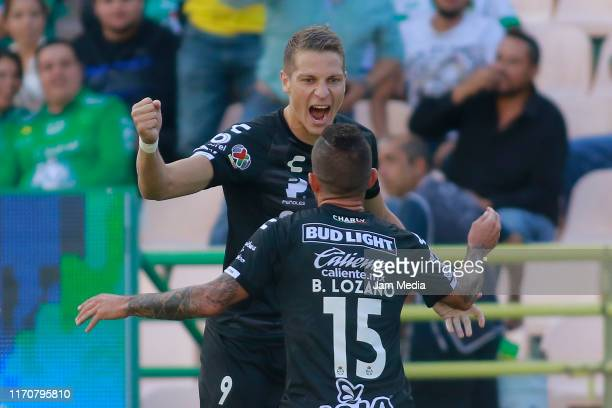 Julio Furch of Santos celebrates with teammates after scoring the first goal of his team during the 7th round match between Leon and Santos Laguna as...