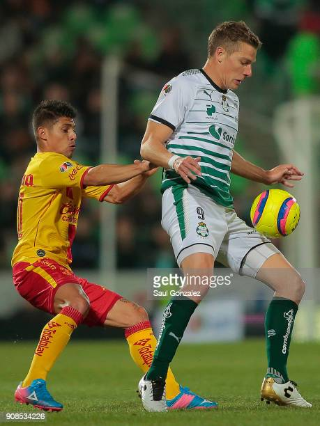 Julio Furch of Santos fights for the ball with Adrian Lezcano of Morelia during the 3rd round match between Santos Laguna and Morelia as part of the...