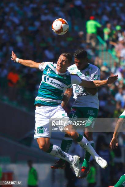 Julio Furch of Santos goes for a header with Alexander Mejia of Leon during the 9th round match between Santos Laguna and Leon as part of the Torneo...