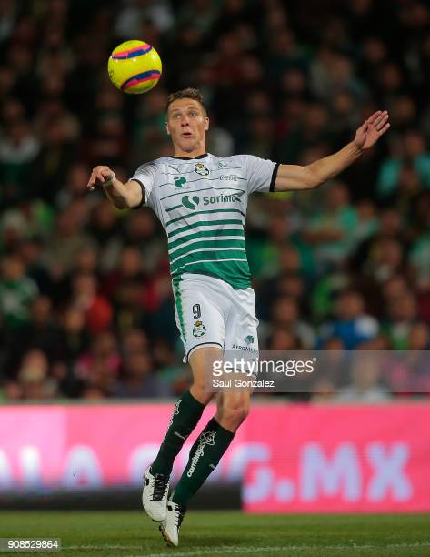 Julio Furch of Santos heads the ball during the 3rd round match between Santos Laguna and Morelia as part of the Torneo Clausura 2018 Liga MX at...