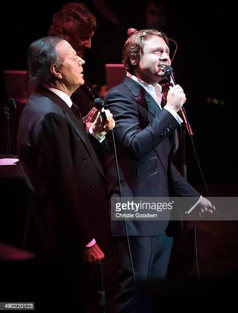 Julio Iglesias and Alexander Kogan perform on stage at Royal Albert Hall on May 13 2014 in London United Kingdom