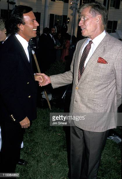 Julio Iglesias and Charlton Heston during USA Today's 5th Anniversary Party at Culver Studios in Culver City California United States