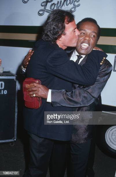 Julio Iglesias and Lou Rawls during Julio Iglesias Sighted at Universal Studios - May 30, 1987 at Universal Studios in Universal City, California,...
