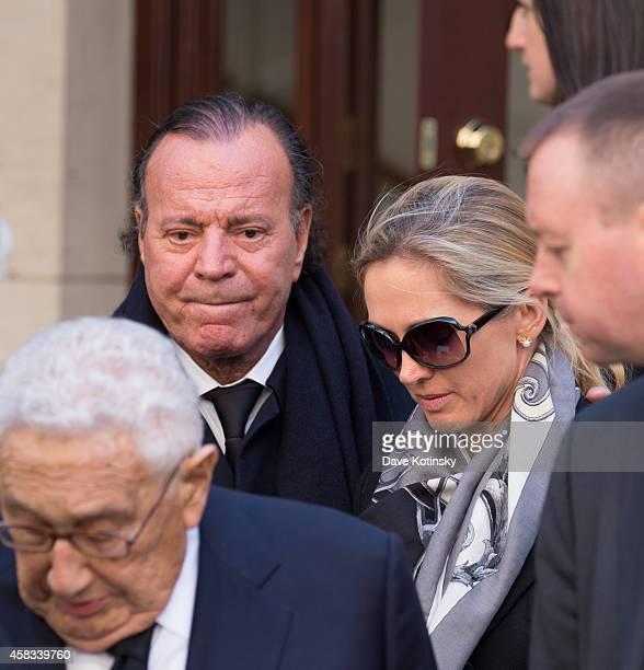 Julio Iglesias and wife Miranda Rijnsburger depart the funeral of fashion designer Oscar De La Renta at St Ignatius Of Loyola on November 3 2014 in...