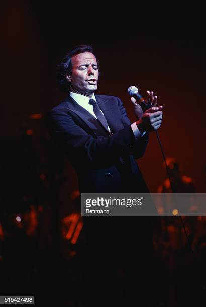 Julio Iglesias on stage at Radio City Music Hall He is shown fulllength with a microphone