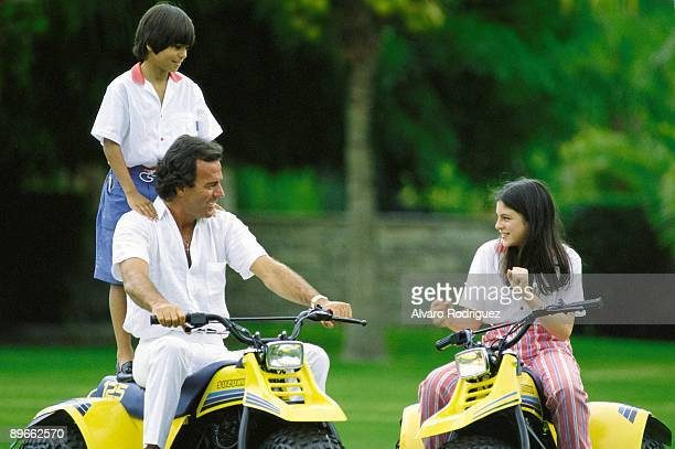 Julio Iglesias with his children Julio Jose and Chabeli The singer and children on quads