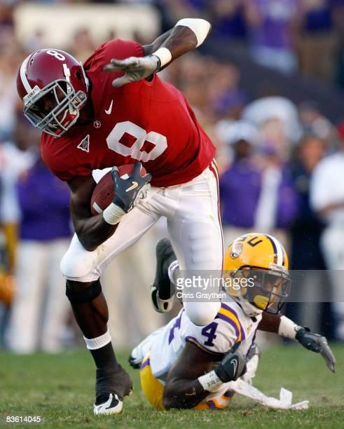 Julio Jones of the Alabama Crimson Tide avoids a tackle by Jai Eugene of the Louisiana State University Tigers on November 11 2008 at Tiger Stadium...