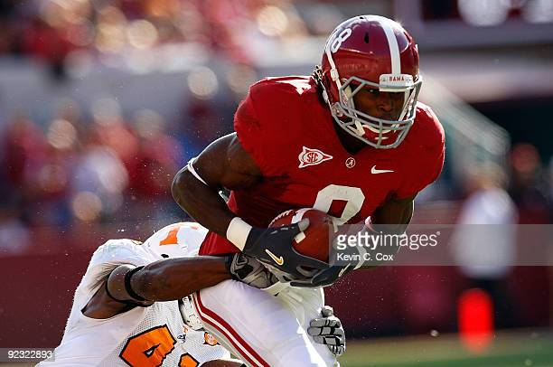 Julio Jones of the Alabama Crimson Tide is tackled by Dennis Rogan of the Tennessee Volunteers at BryantDenny Stadium on October 24 2009 in...