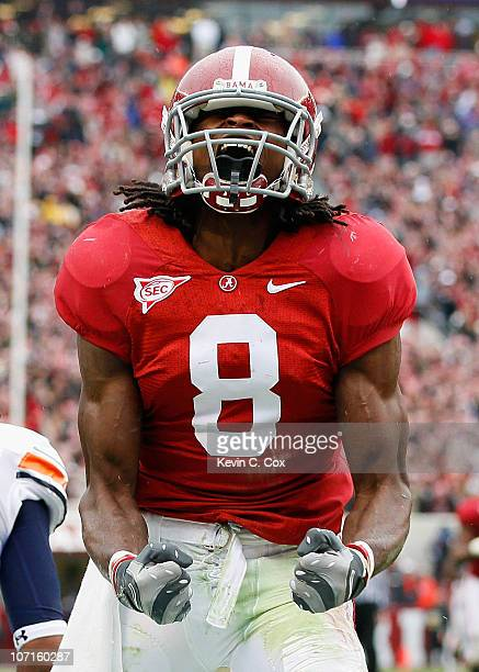 Julio Jones of the Alabama Crimson Tide reacts after a long reception against the Auburn Tigers at Bryant-Denny Stadium on November 26, 2010 in...