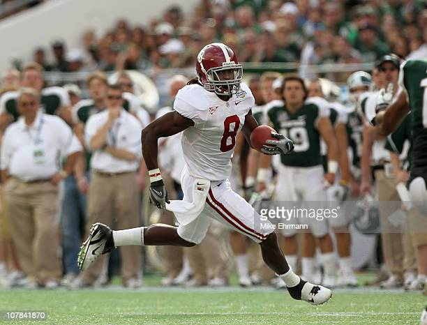 Julio Jones of the Alabama Crimson Tide rushes for a touchdown during the Capitol One Bowl against the Michigan State Spartans at the Florida Citrus...