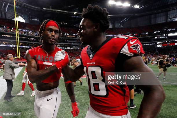 Julio Jones of the Atlanta Falcons and Calvin Ridley walk off the field after beating the Carolina Panthers at Mercedes-Benz Stadium on September 16,...