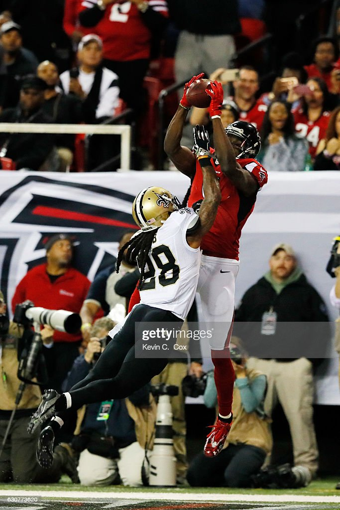 Julio Jones #11 of the Atlanta Falcons catches a touchdown over B.W. Webb #28 of the New Orleans Saints during the first half at the Georgia Dome on January 1, 2017 in Atlanta, Georgia.