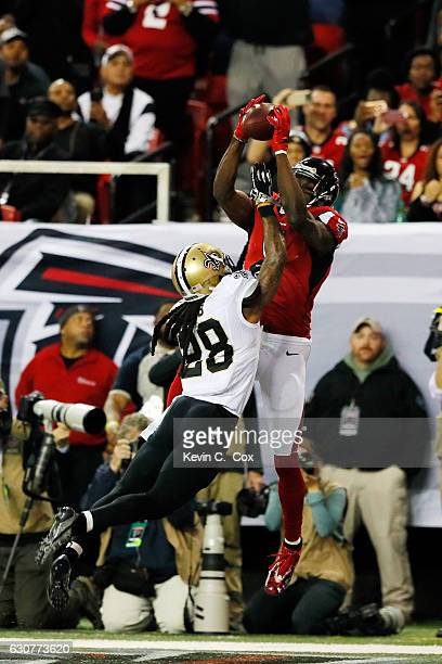 Julio Jones of the Atlanta Falcons catches a touchdown over BW Webb of the New Orleans Saints during the first half at the Georgia Dome on January 1...