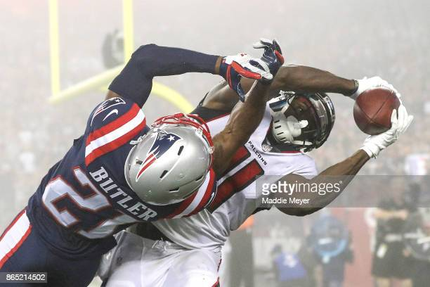 Julio Jones of the Atlanta Falcons catches a touchdown pass as he is defended by Malcolm Butler of the New England Patriots during the fourth quarter...
