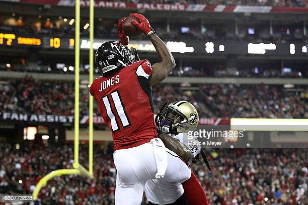 Julio Jones of the Atlanta Falcons catches a touchdown pass over BW Webb of the New Orleans Saints during the first half at the Georgia Dome on...