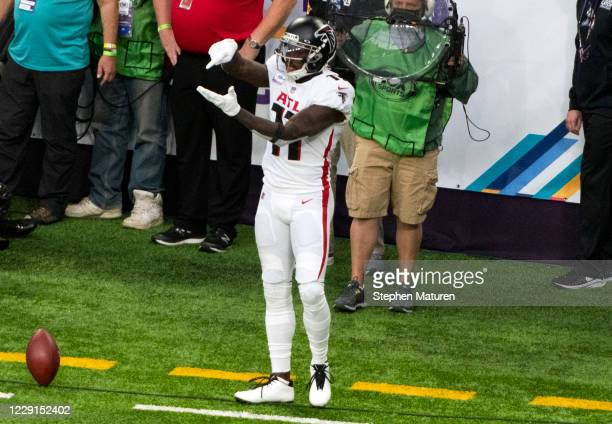 Julio Jones of the Atlanta Falcons celebrates after scoring a touchdown in the first quarter of the game against the Minnesota Vikings at US Bank...