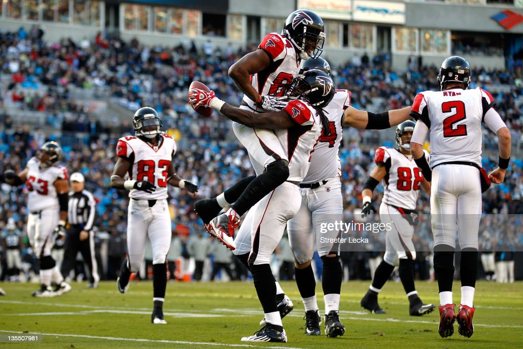 Julio Jones #11 of the Atlanta Falcons celebrates after scoring a touchdown with teammate Roddy White #83 during their game against the Carolina Panthers at Bank of America Stadium on December 11, 2011 in Charlotte, North Carolina.