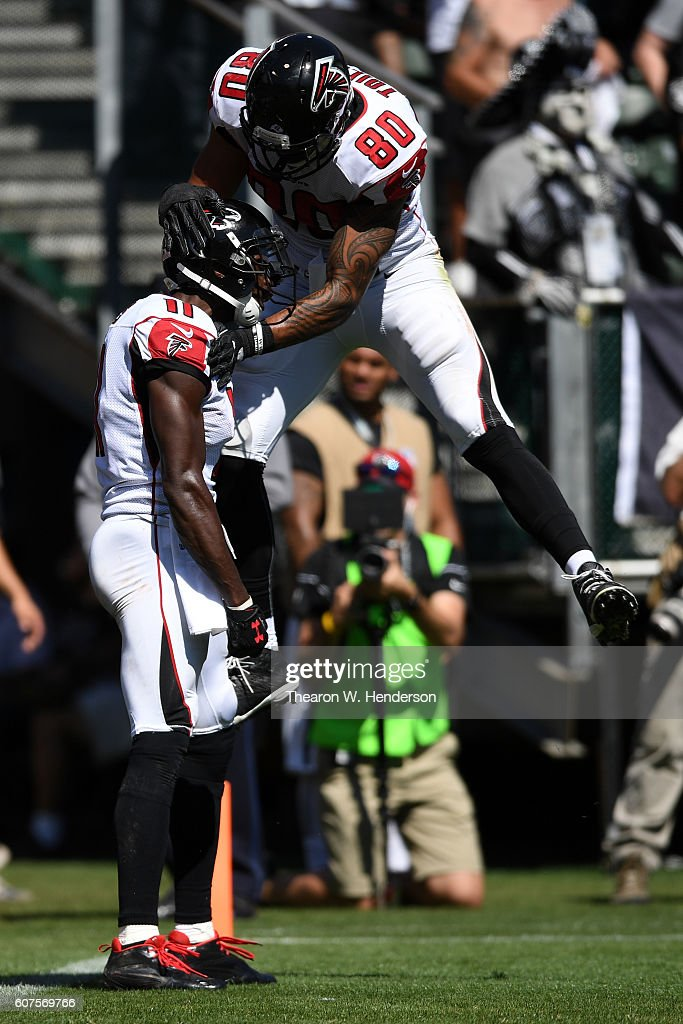 Julio Jones #11 of the Atlanta Falcons celebrates with Levine Toilolo #80 after a 21-yard touchdown against the Oakland Raiders during their NFL game at Oakland-Alameda County Coliseum on September 18, 2016 in Oakland, California.