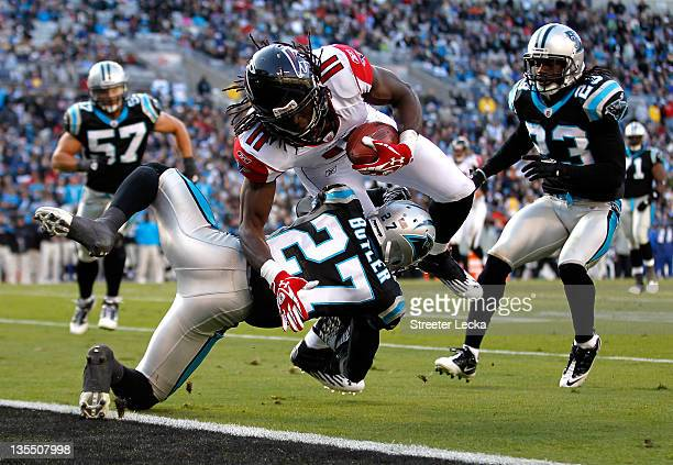 Julio Jones of the Atlanta Falcons dives for a touchdown during their game against Darius Butler of the Carolina Panthers at Bank of America Stadium...