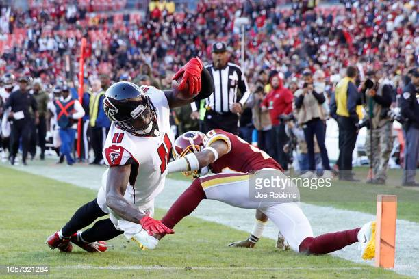 Julio Jones of the Atlanta Falcons dives into the end zone for a 35yard touchdown in the fourth quarter of the game against the Washington Redskins...