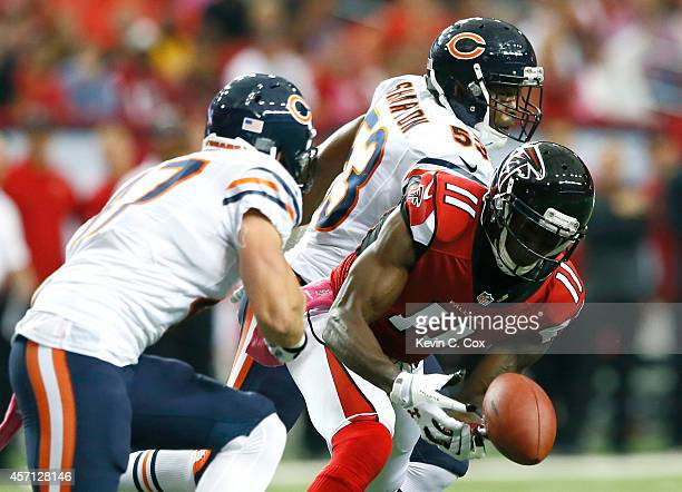 Julio Jones of the Atlanta Falcons fails to pull in this reception against Darryl Sharpton and Chris Conte of the Chicago Bears at Georgia Dome on...