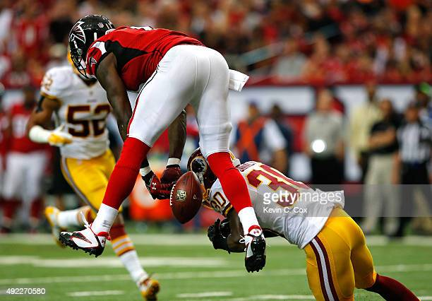 Julio Jones of the Atlanta Falcons fails to pull in this reception against Kyshoen Jarrett of the Washington Redskins at Georgia Dome on October 11...