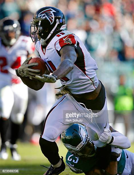 Julio Jones of the Atlanta Falcons has his pants grabbed by Rodney McLeod of the Philadelphia Eagles during a game at Lincoln Financial Field on...