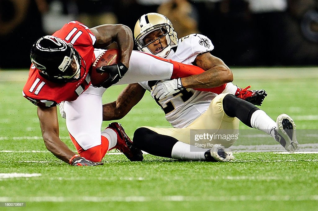 Julio Jones #11 of the Atlanta Falcons is brought down Corey White #24 of the New Orleans Saints during a game at the Mercedes-Benz Superdome on September 8, 2013 in New Orleans, Louisiana. The Saints defeated the Atlanta Falcons 23-17.
