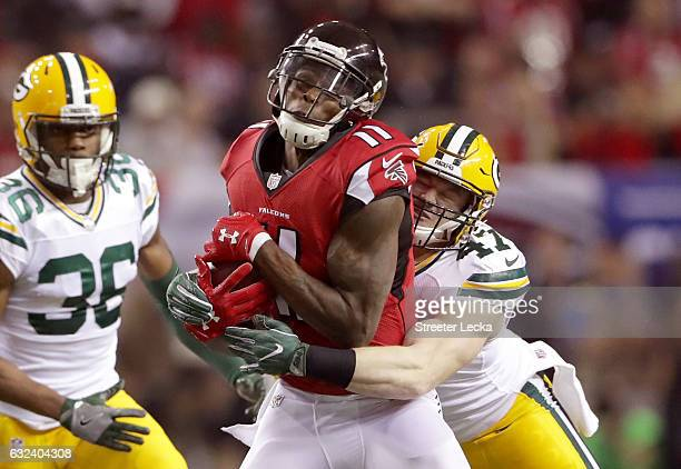 Julio Jones of the Atlanta Falcons is hit by Jake Ryan of the Green Bay Packers in the first quarter in the NFC Championship Game at the Georgia Dome...
