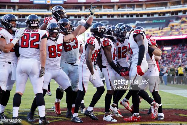 Julio Jones of the Atlanta Falcons is mobbed by teammates after catching a 35yard touchdown pass in the fourth quarter of the game against the...