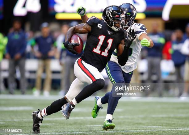 Julio Jones of the Atlanta Falcons is tackled by Akeem King of the Seattle Seahawks in the second half of an NFL game at MercedesBenz Stadium on...