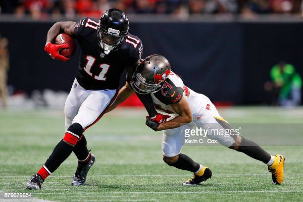 Julio Jones of the Atlanta Falcons is tackled by Brent Grimes of the Tampa Bay Buccaneers during the second half at MercedesBenz Stadium on November...