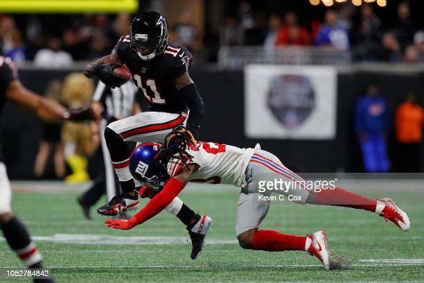 Julio Jones of the Atlanta Falcons is tackled by Janoris Jenkins of the New York Giants during the fourth quarter at Mercedes-Benz Stadium on October...