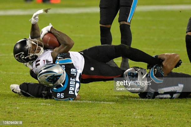 Julio Jones of the Atlanta Falcons is tackled by Jeremy Chinn and Troy Pride Jr. #25 of the Carolina Panthers during the third quarter at Bank of...