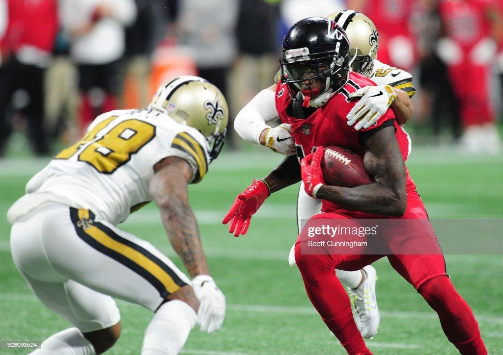 7ff008d11cb Julio Jones of the Atlanta Falcons is tackled by Marshon Lattimore ...