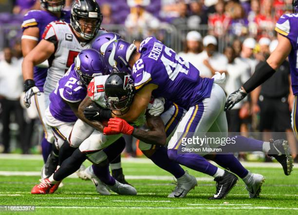 Julio Jones of the Atlanta Falcons is tackled by multiple Minnesota Vikings defenders in the fourth quarter of the game at US Bank Stadium on...
