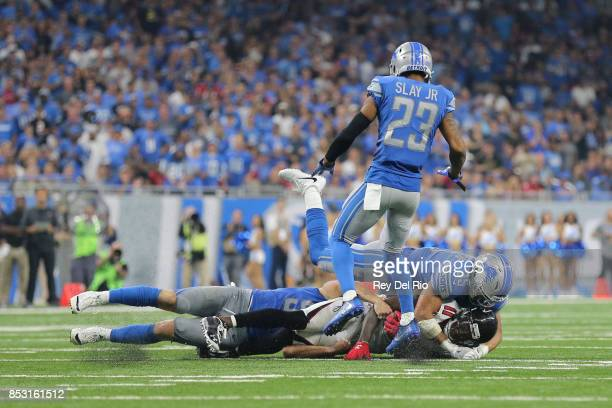 Julio Jones of the Atlanta Falcons makes a catch and tackled by Miles Killebrew of the Detroit Lions at Ford Field on September 24, 2017 in Detroit,...