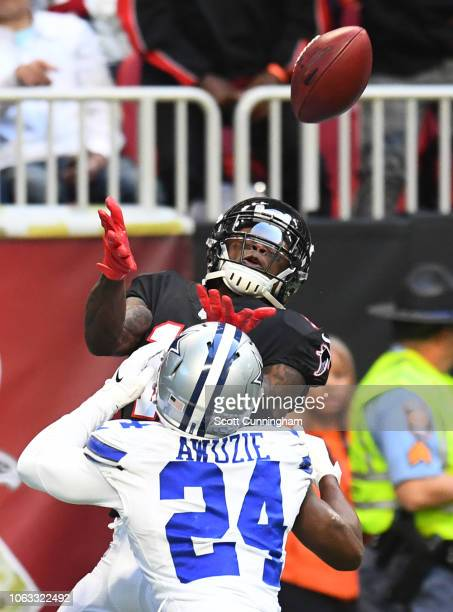 Julio Jones of the Atlanta Falcons makes a catch for a fourth quarter touchdown against Chidobe Awuzie of the Dallas Cowboys at MercedesBenz Stadium...