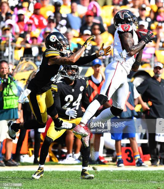 Julio Jones of the Atlanta Falcons makes a catch in front of Joe Haden and Coty Sensabaugh of the Pittsburgh Steelers in the second half at Heinz...