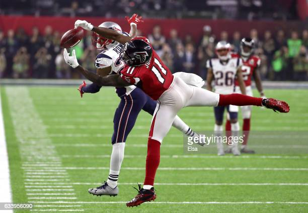 Julio Jones of the Atlanta Falcons makes a catch over Eric Rowe of the New England Patriots during the fourth quarter during Super Bowl 51 at NRG...