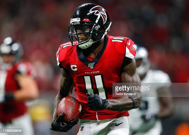 Julio Jones of the Atlanta Falcons makes a reception and rushes in for a touchdown late in an NFL game against the Philadelphia Eagles at...