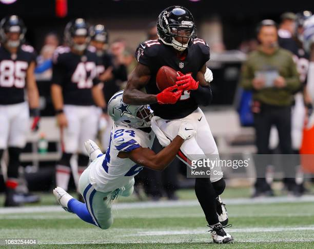 Julio Jones of the Atlanta Falcons pulls in this reception against Chidobe Awuzie of the Dallas Cowboys at MercedesBenz Stadium on November 18 2018...
