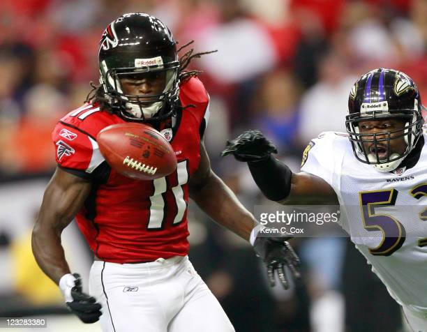 Julio Jones of the Atlanta Falcons pulls in this reception against Jameel McClain of the Baltimore Ravens at Georgia Dome on September 1 2011 in...