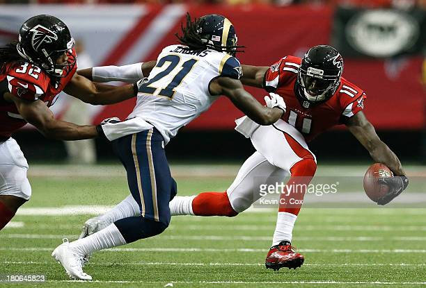 Julio Jones of the Atlanta Falcons pulls in this reception against Janoris Jenkins of the St Louis Rams at Georgia Dome on September 15 2013 in...