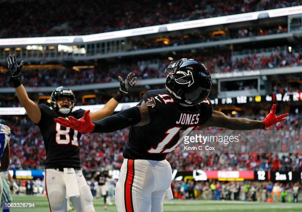 Julio Jones of the Atlanta Falcons reacts after pulling in a touchdown reception against the Dallas Cowboys at MercedesBenz Stadium on November 18...