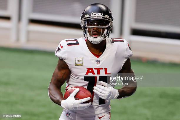 Julio Jones of the Atlanta Falcons reacts after scoring a touchdown during the third quarter against the Denver Broncos at Mercedes-Benz Stadium on...