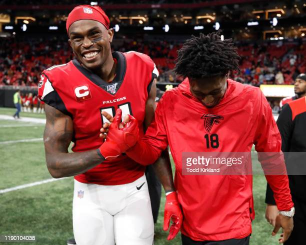 Julio Jones of the Atlanta Falcons reacts with Calvin Ridley at the conclusion of an NFL game against the Jacksonville Jaguars at Mercedes-Benz...