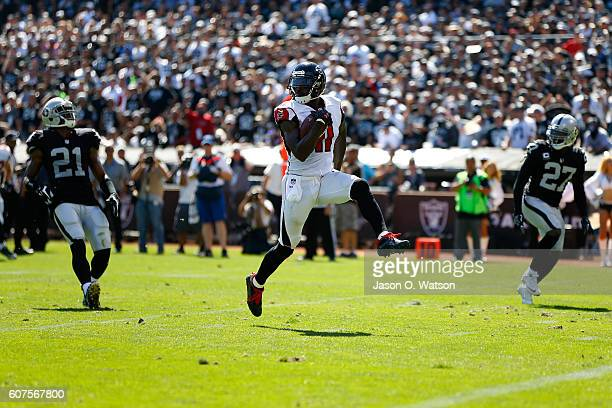 Julio Jones of the Atlanta Falcons runs after a catch for a 21yard touchdown against the Oakland Raiders during their NFL game at OaklandAlameda...