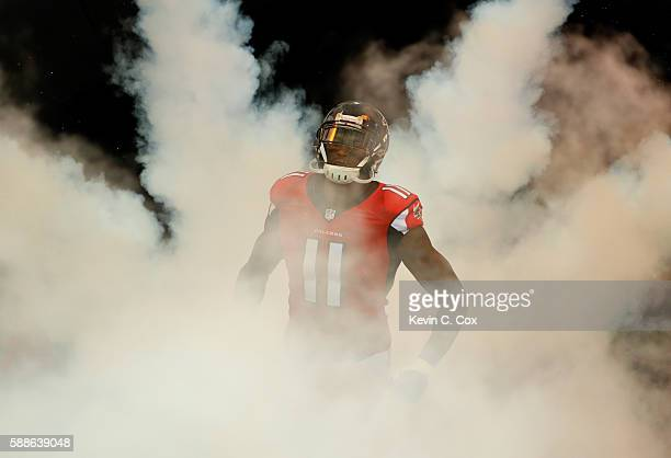 Julio Jones of the Atlanta Falcons runs on the field during player introductions prior to facing the Washington Redskins at Georgia Dome on August 11...